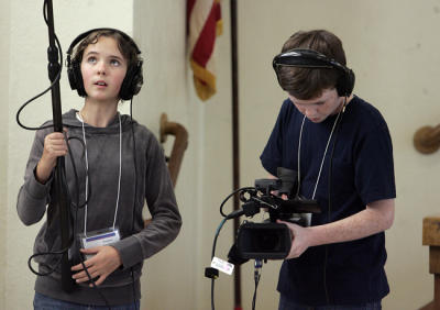 Addison Hunter, 12 (right), and Brian Niles, 11 (left), of Marshall Fundamental, document Principal Frances Weissenberger at Hamilton Elementary School as part of the GO PUBLIC documentary project. (San Gabirel Valley News/Staff Photo by Sarah Reingewirtz)